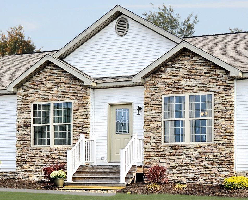 Hand laid stone exterior accents pennwest homes for Stone accents